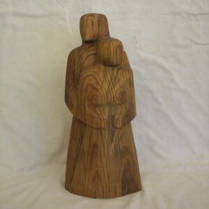 Wood sculpture of couple together